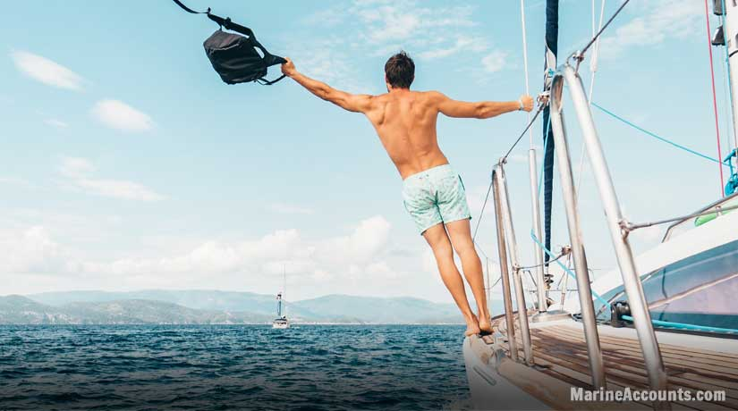 Man Leaning From Yacht Cables